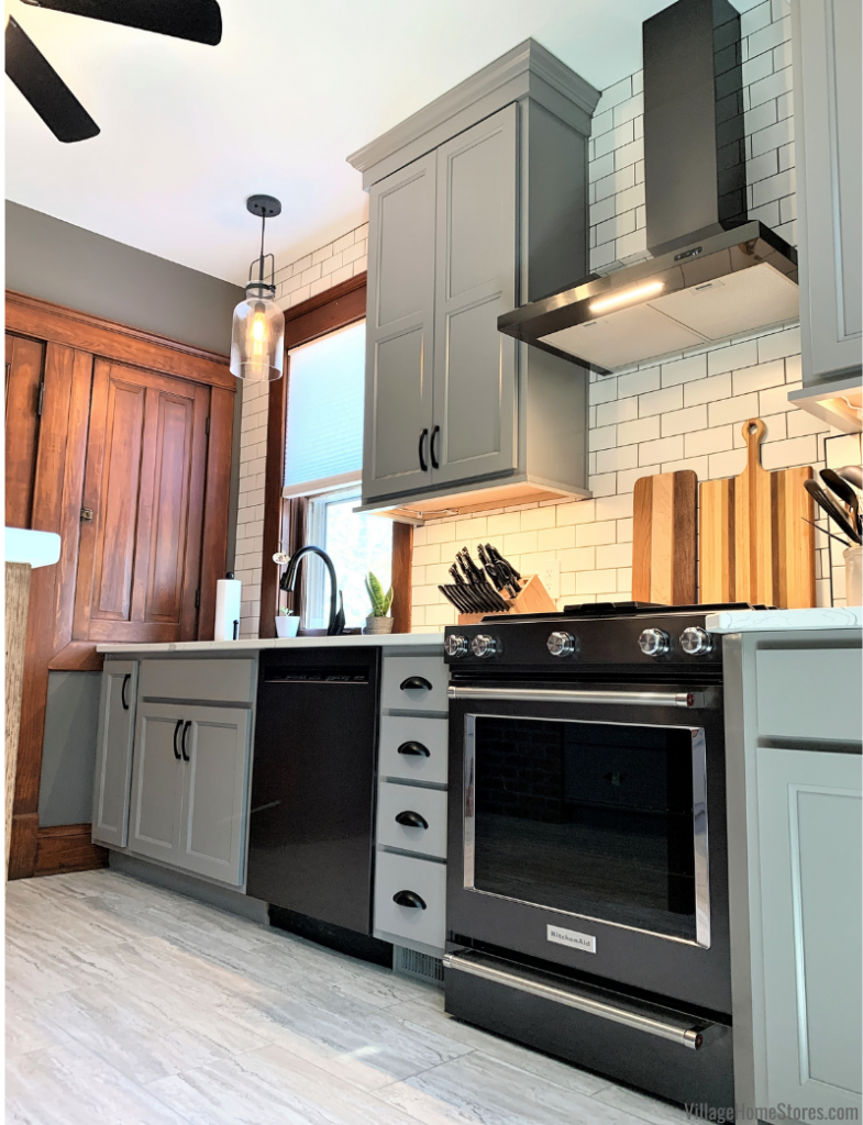 Kitchen Aid Black Stainless appliances installed in a Fog gray painted kitchen cabinet design. Kitchen design and complete remodel by Village Home Stores in Geneseo, Illinois.
