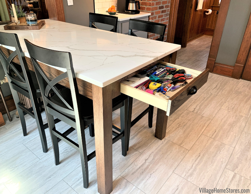 Custom kitchen table with drawer used as peninsula kitchen island in a Geneseo Illinois kitchen designed and remodeled by Village Home Stores.