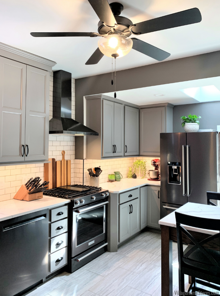 kitchen design with two ceiling heights and wall depth change. Design, materials, and complete start to finish remodel by Village Home Stores.