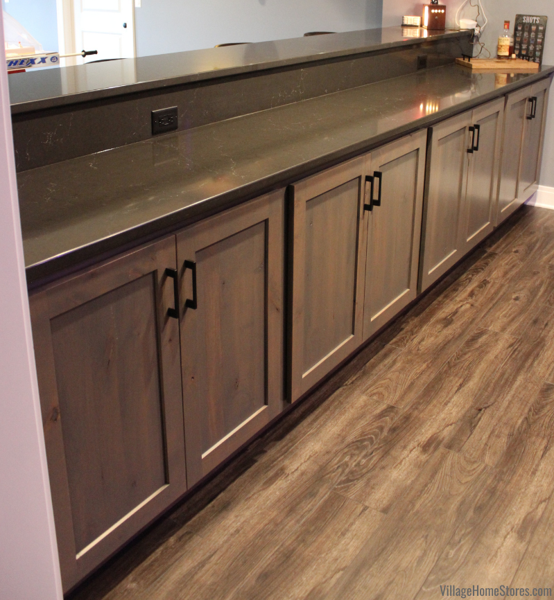 Knotty Alder Koch Cabinets in warm gray Driftwood stain paired with Cambria Quartz in the Charlestown design.