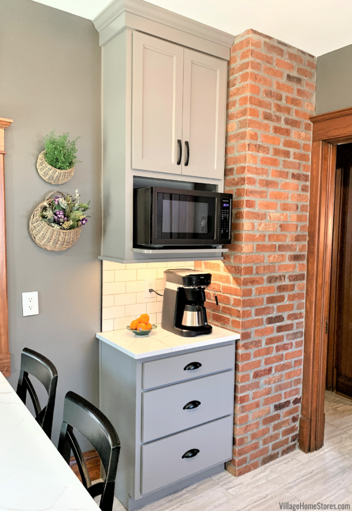 Microwave shelf cabinet with Black Stainless microwave in coffee station of a Village Home Stores kitchen design.