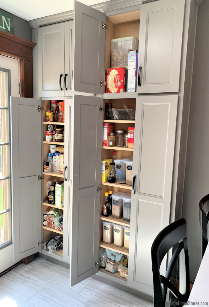 Tall, shallow pantry cabinets in Geneseo Illinois kitchen by Village Home Stores. Koch Cabinetry in Bristol door and Fog paint.