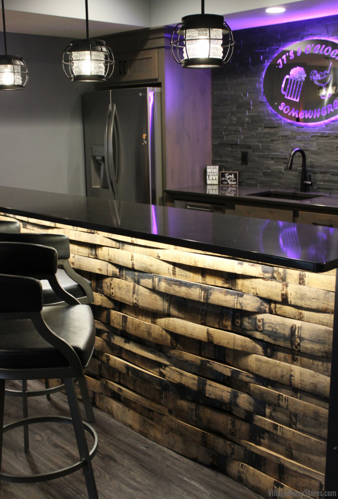 Home bar in Bettendorf Iowa with whiskey barrel planks, Cambria Quartz counters, and Galveston pendant lights.