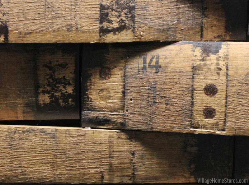 Close up of Templeton Rye Whiskey barrels used as planks for the back of a home bar in Bettendorf Iowa.
