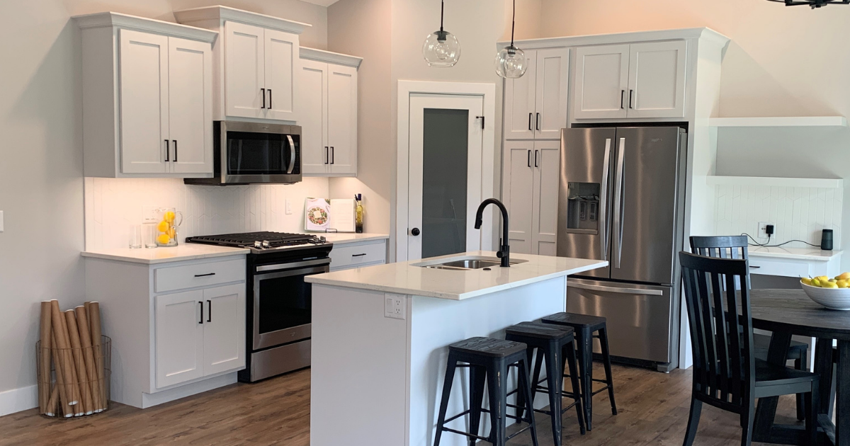 """Seng Meadows model home in Davenport, Iowa with select design and materials by Village Home Stores for McCoy Homes. Koch Express Cabinetry in Windsor White and MSI """"Carrera Marmi"""" quartz counters."""