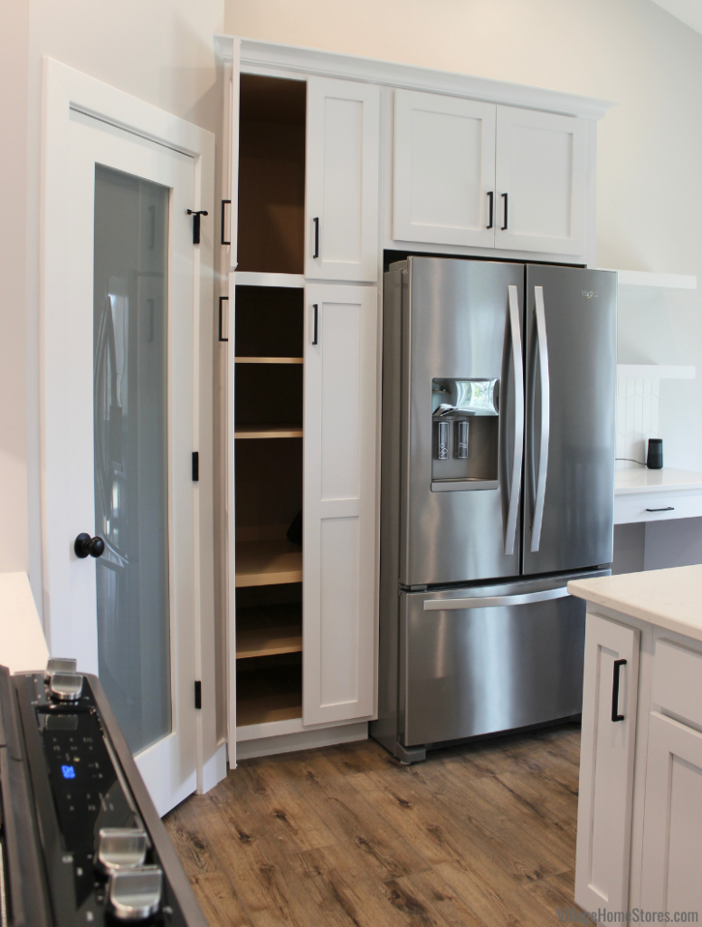 Painted white Koch Express cabinet kitchen with pantry in Davenport Iowa.