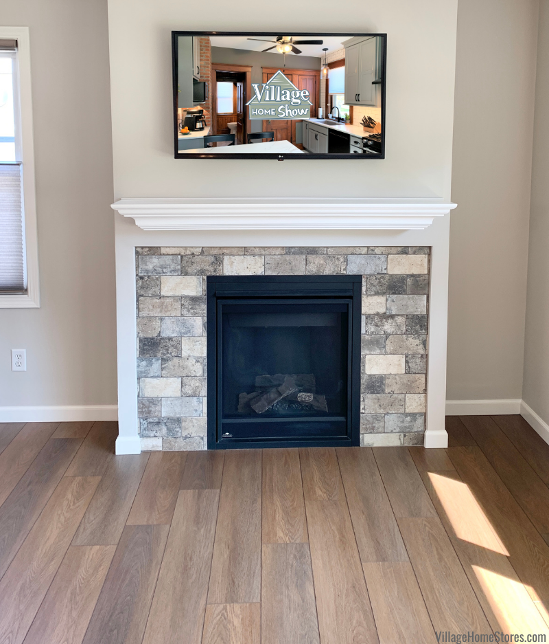 Fireplace surround in Geneseo, Illinois using brick look tiles New York Deco in the Broadway color.