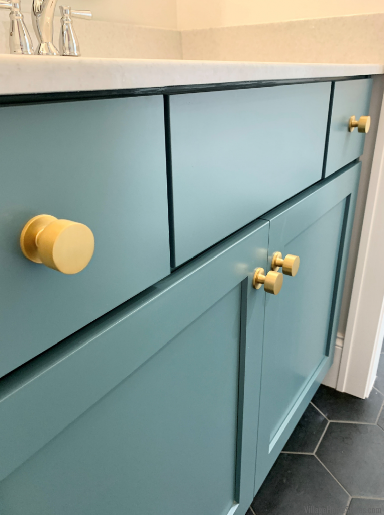 Teal Capri painted finish from Koch Cabinetry in a Moline, IL jack and jill bathroom design from Village Home Stores.