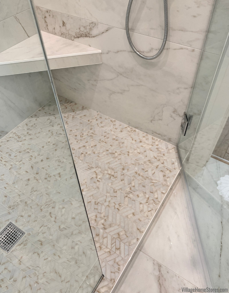 Calacatta Oro chevron tiled shower floor. Tile by Village Home Stores for Hazelwood Homes.