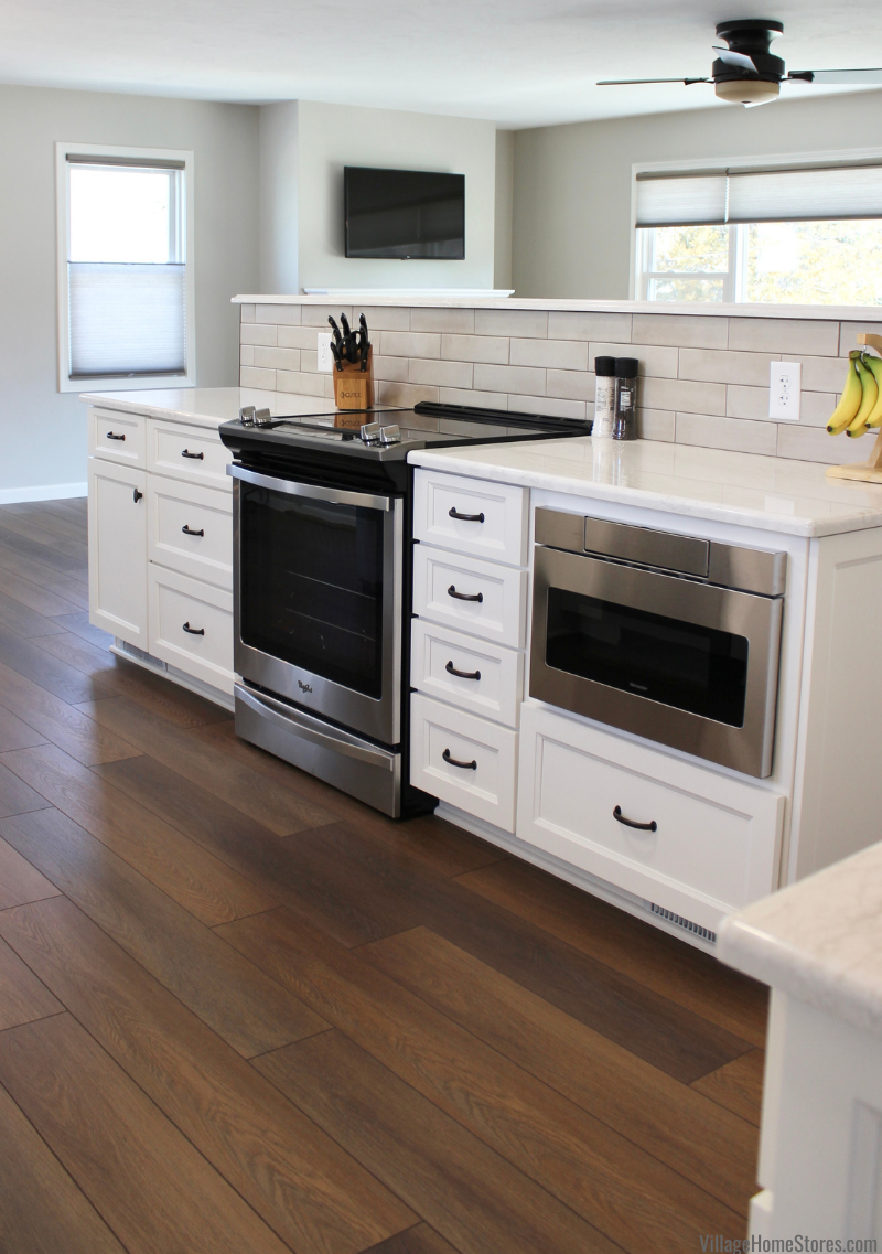 Kitchen island on COREtec floors with Whirlpool electric range and Sharp microwave drawer.