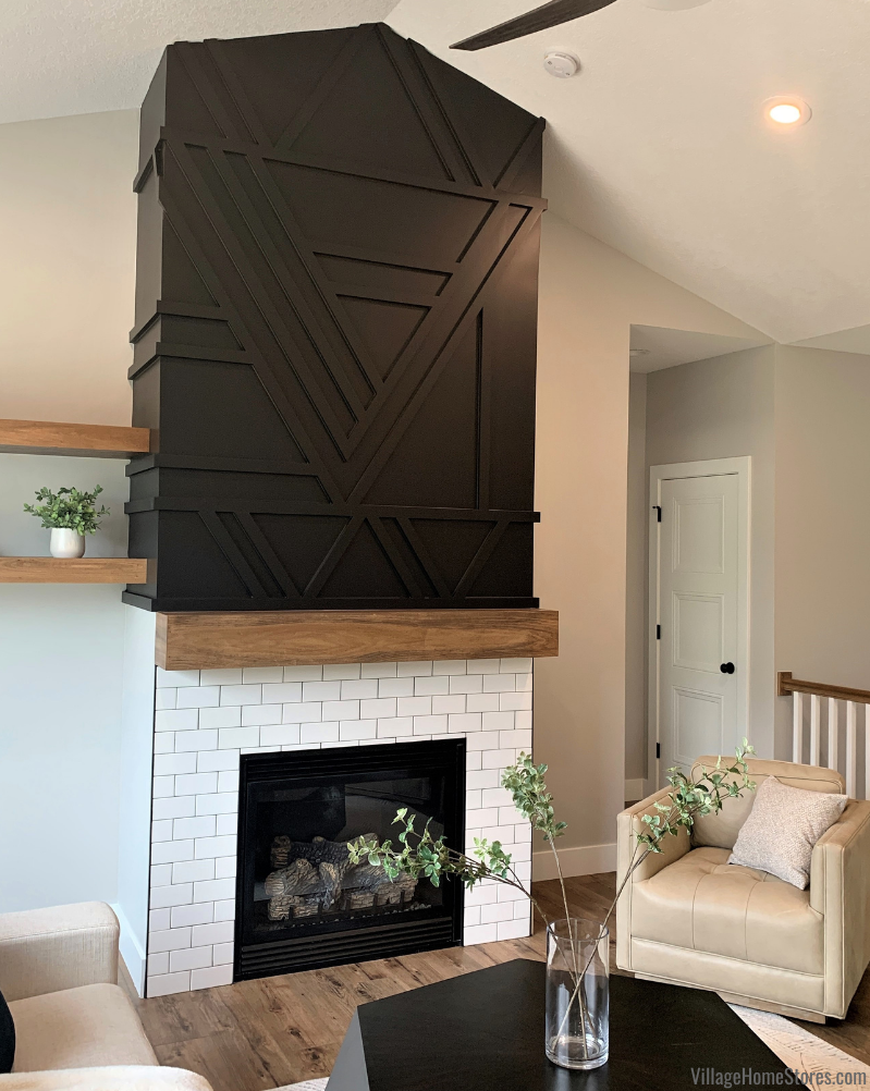 Geometric matte black fireplace with Arctic White classic 3x6 subway tile. Flooring and tile by Village Home Stores.