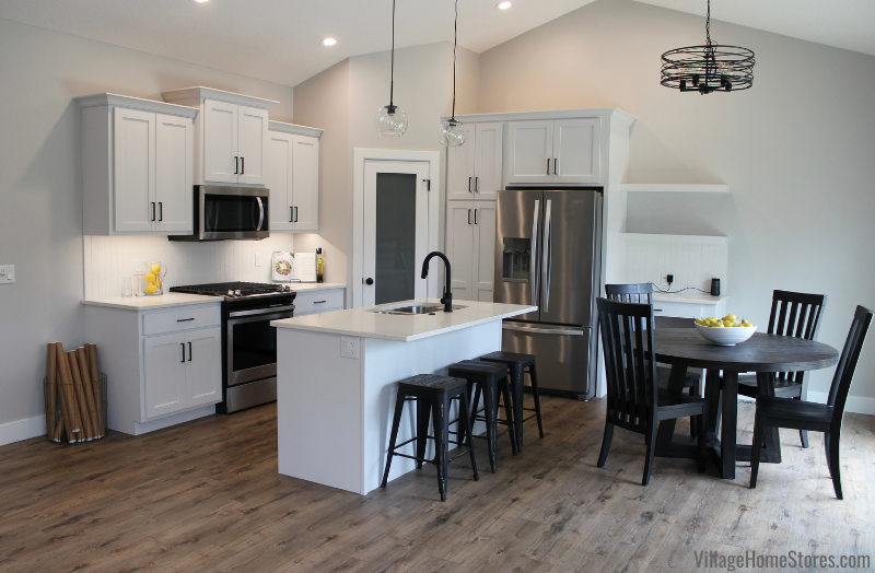 Koch Express cabinet open concept kitchen in Seng Meadows McCoy Homes model. Design and select materials by Village Home Stores.