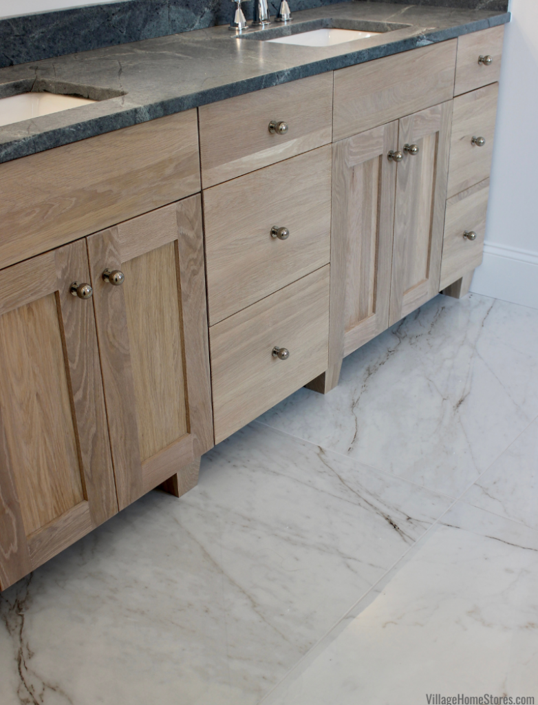 Classentino Marble large format tiles in a primary bath. Cabinetry and tile by Village Home Stores for Hazelwood Homes.