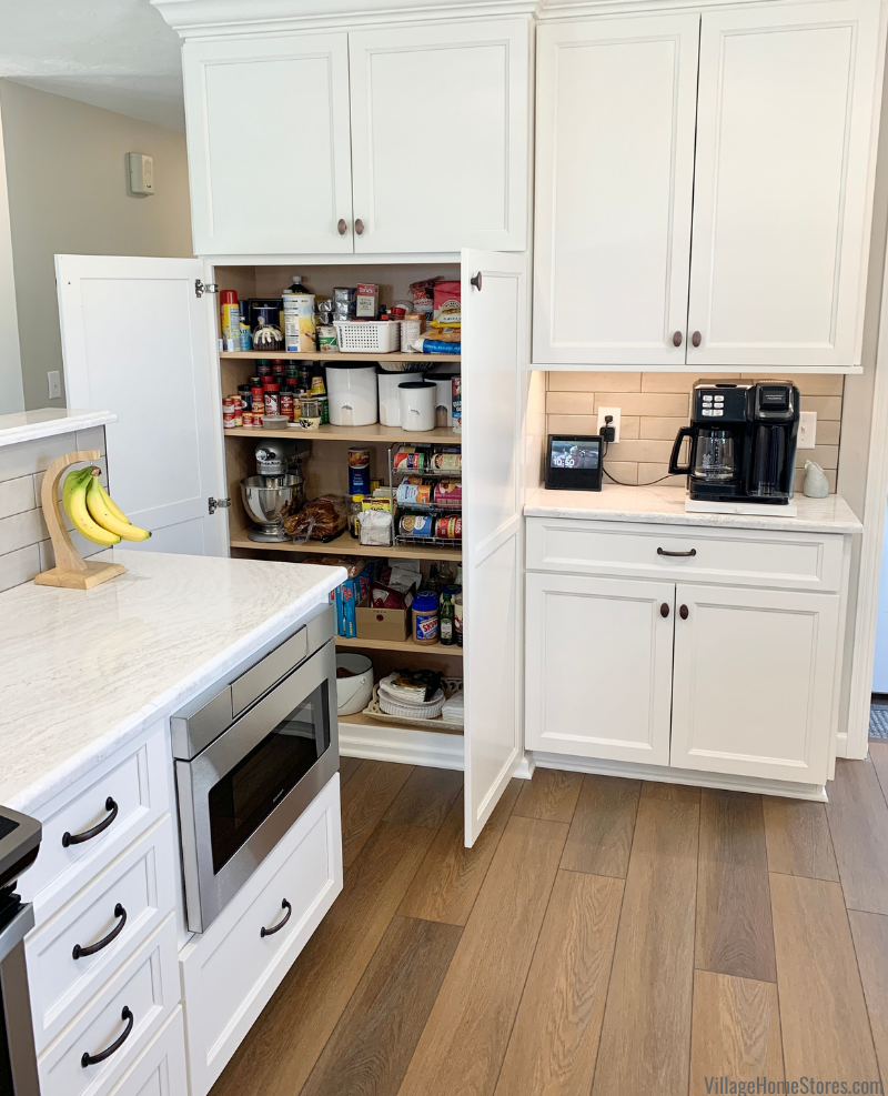 Tall shallow pantry cabinet and coffee station in kitchen design.