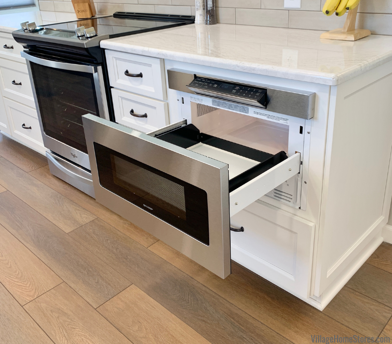 Sharp flat panel microwave drawer installed in a kitchen island.