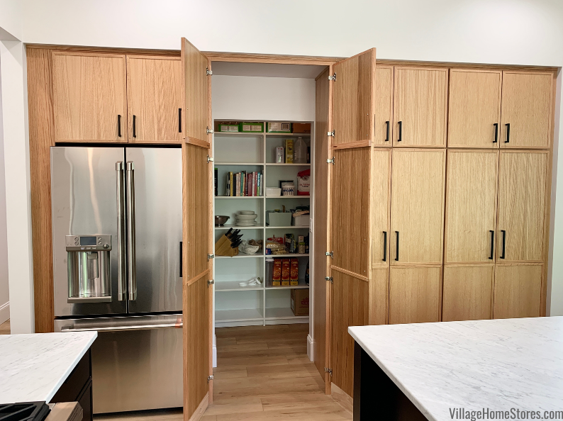 Walk in pantry cabinet doors in rift cut oak natural skinny shaker Bedford door by Koch Cabinetry. Kitchen cabinetry by Village Home Stores for Hazelwood Homes of the Quad Cities.