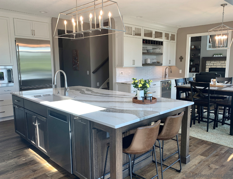 """Kitchen remodel with wet bar area in Bettendorf, Iowa with Amish-built cabinets in a combination of """"Warm White"""" paint and quarter sawn White Oak in a """"Charcoal"""" stain""""- Village Home Stores."""