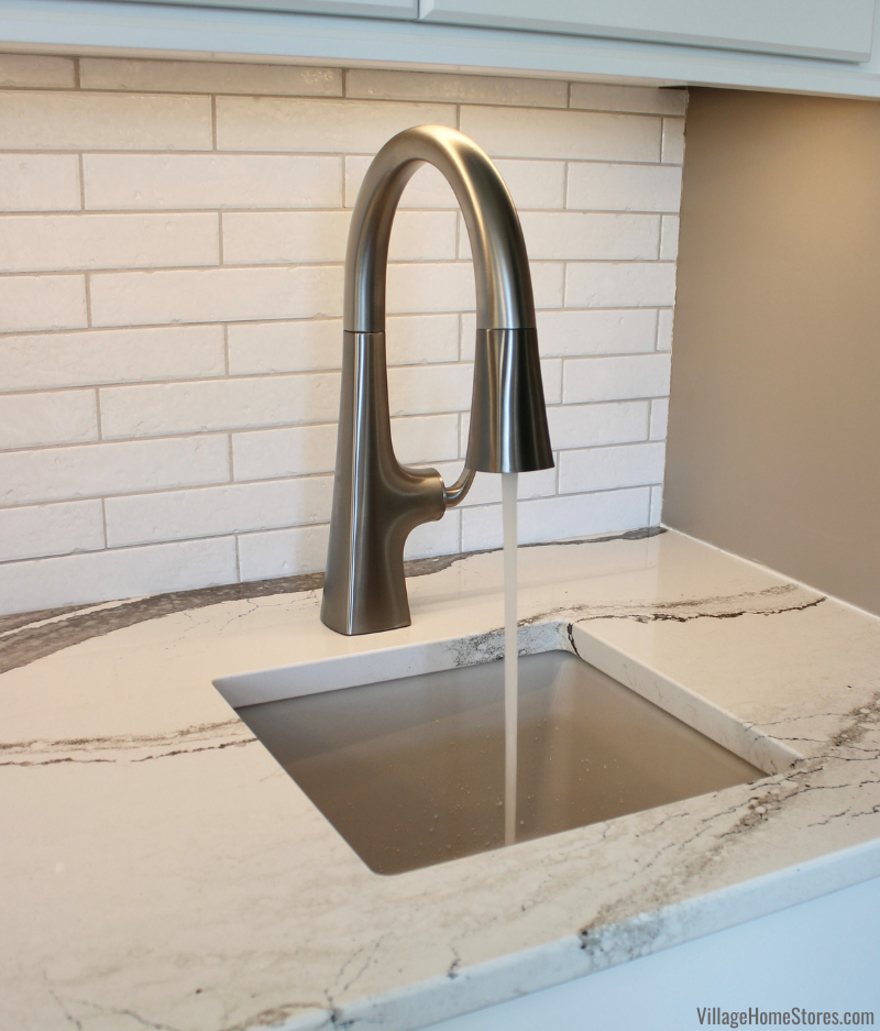 Kohler bar faucet with spray arm installed with an Elkay Putty colored bar sink in a Bettendorf Iowa kitchen remodeled by Village Home Stores.