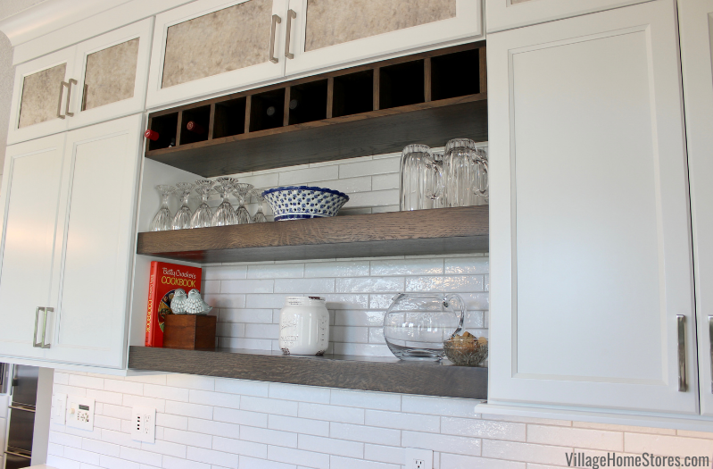 Kitchen wet bar open shelves and wine cubbie shelf in a Bettendorf Iowa home remodeled by Village Home Stores.