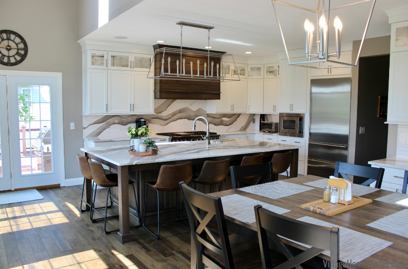 Bettendorf Iowa kitchen remodel with table and kitchen island with seating.