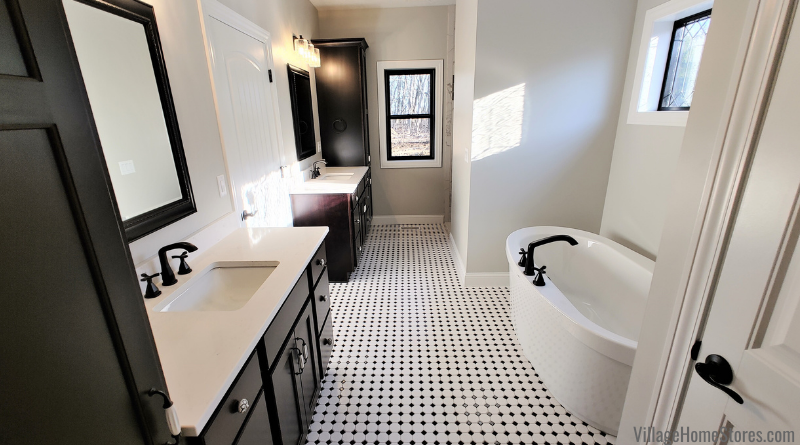 Dark Java stained bath vanities and linen cabinets on black and white octagon with dot tiled floor.