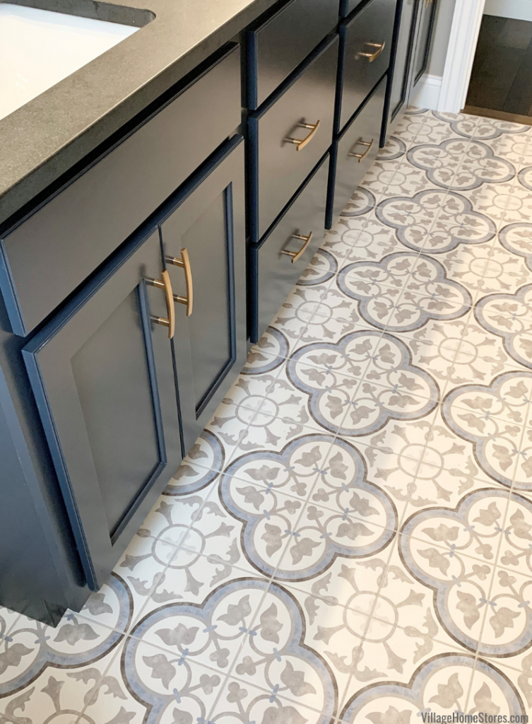 Charcoal Blue painted vanity cabinet with gold hardware on painted tile floor in a Coal Valley Illinois home.
