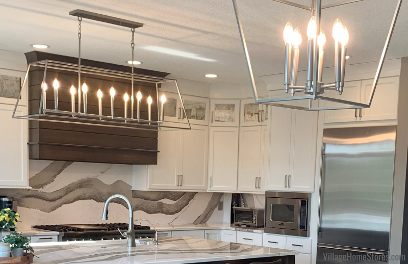 Quorum Gabriel lantern-shaped lighting installed above a kitchen island and table in Bettendorf, Iowa.