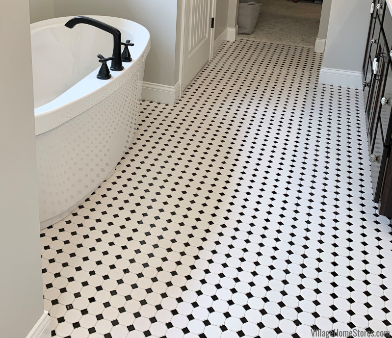 Black and white small classic tiles installed for the floor of a Coal Valley Illinois primary bathroom. Tile by Village Home Stores for Hazelwood Homes.