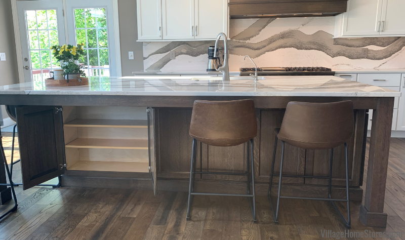 Kitchen island with hidden cabinet storage under the seating overhang area in a Bettendorf, Iowa kitchen remodeled by Village Home Store.