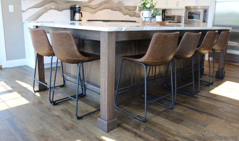 Kitchen island cabinetry with seating overhang and furniture style leg. Amish cabinetry in Quarter-Sawn White Oak with Charcoal stain applied.