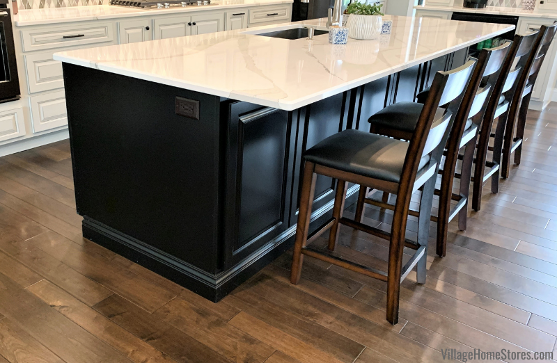Dark cabinet kitchen island with Cambria Brittanicca quartz tops. Cabinets and tops from the Quad Cities kitchen experts at Village Home Stores.