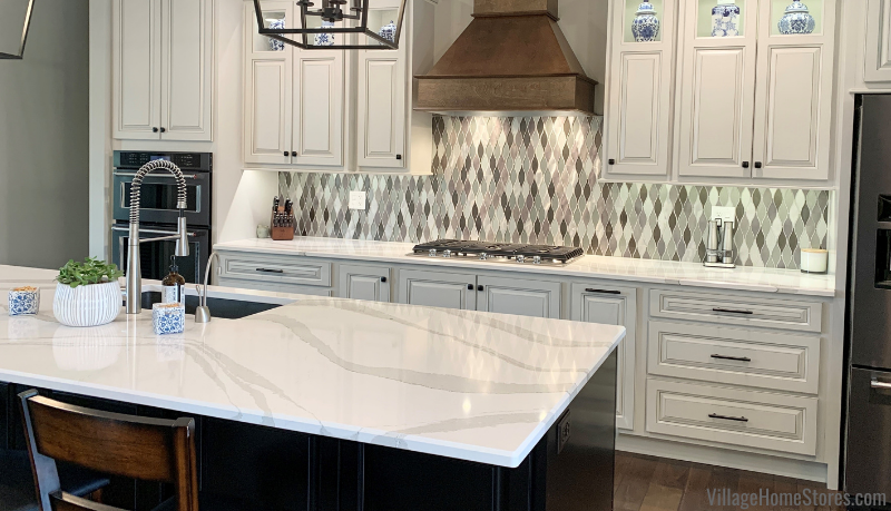 Quad Cities area kitchen with Cambria Brittanicca quartz tops and metal and glass mosaic tile backsplash.