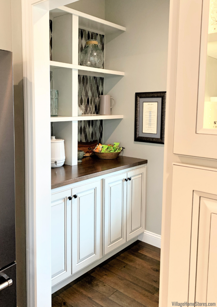 Open pantry and wine storage space off kitchen design in a new home built in Coal Valley, Illinois. Design and materials by Village Home Stores for Hazelwood Homes.