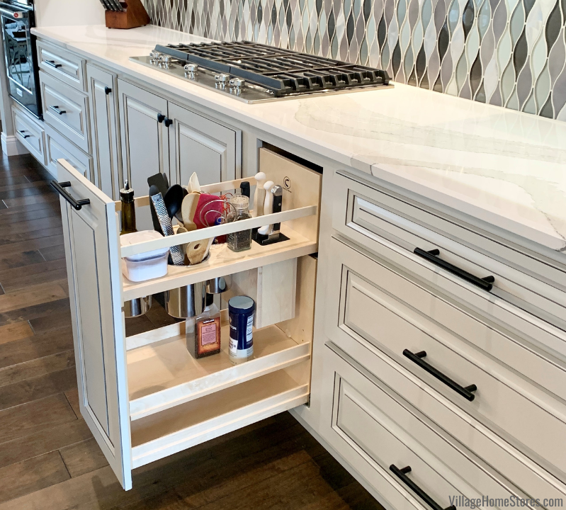 Pullout cabinet with knife block in a new home built in Coal Valley, Illinois.
