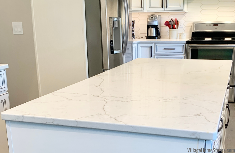 MSI Calacatta Valentin quartz countertops in a Geneseo, Illinois kitchen designed and remodeled by Village Home Stores.