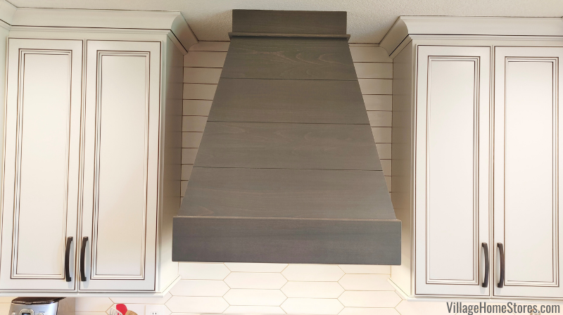 Ivory painted cabinets with Umber highlights and accent shiplap wood range cabinet hood in Rustic Beech Driftwood.