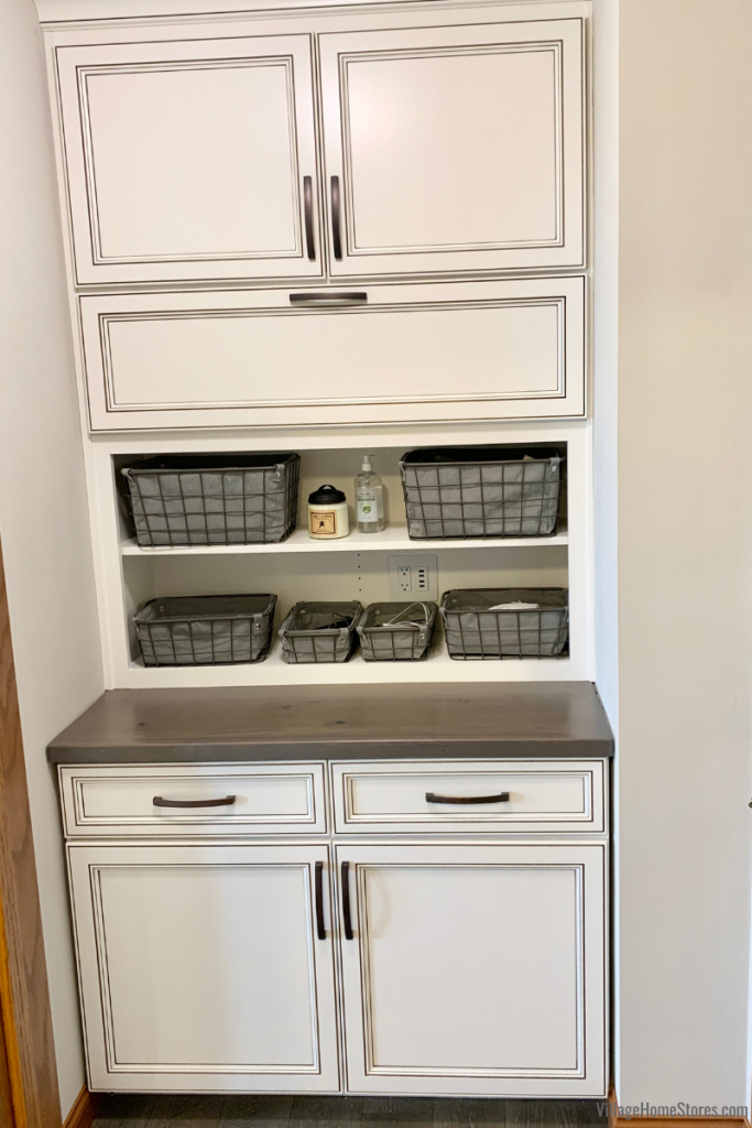 Closet area converted into dropzone. Geneseo, Illinois kitchen design and remodel by Village Home Stores.