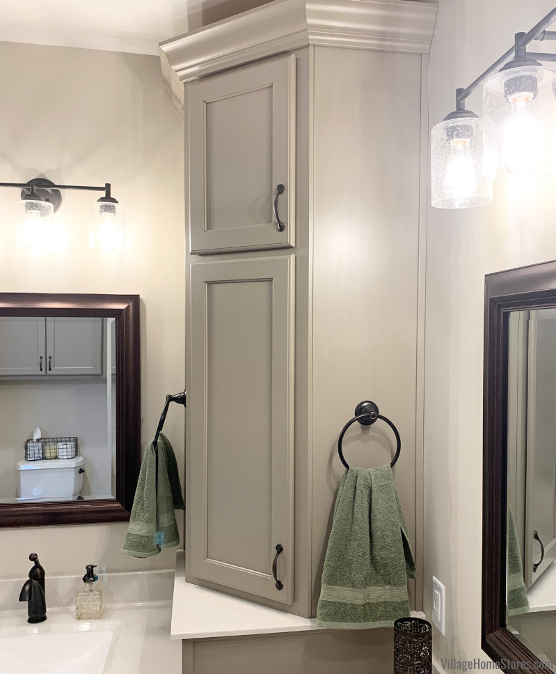 """Angled corner wall cabinet for bathroom storage. Koch Prairie door style and """"Taupe"""" painted finish."""