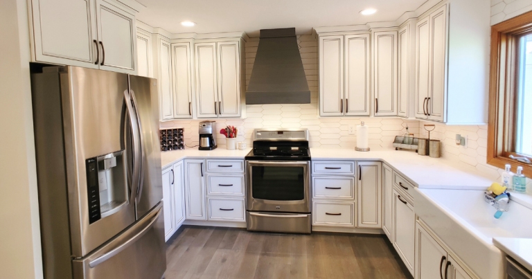 Kitchen remodel in a Geneseo, Illinois by Village Home Stores with warm gray flooring and ivory painted cabinetry.