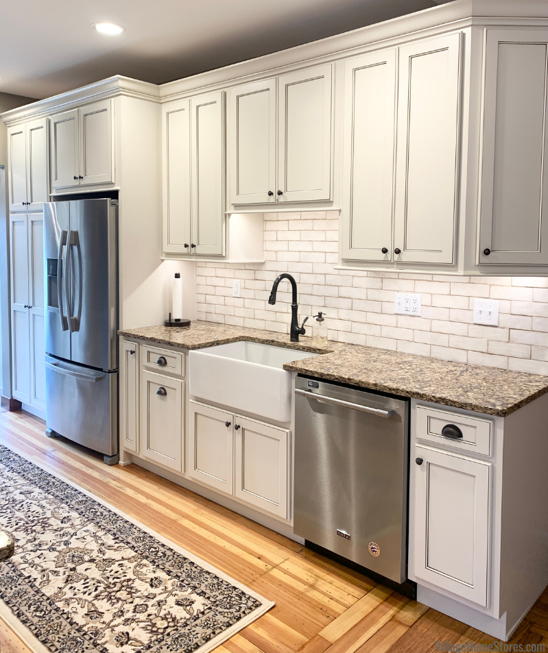 Kitchen cabinets and countertops installed in a remodeled Alexia, Illinois farmhouse. Design and full remodel by Village Home Stores.